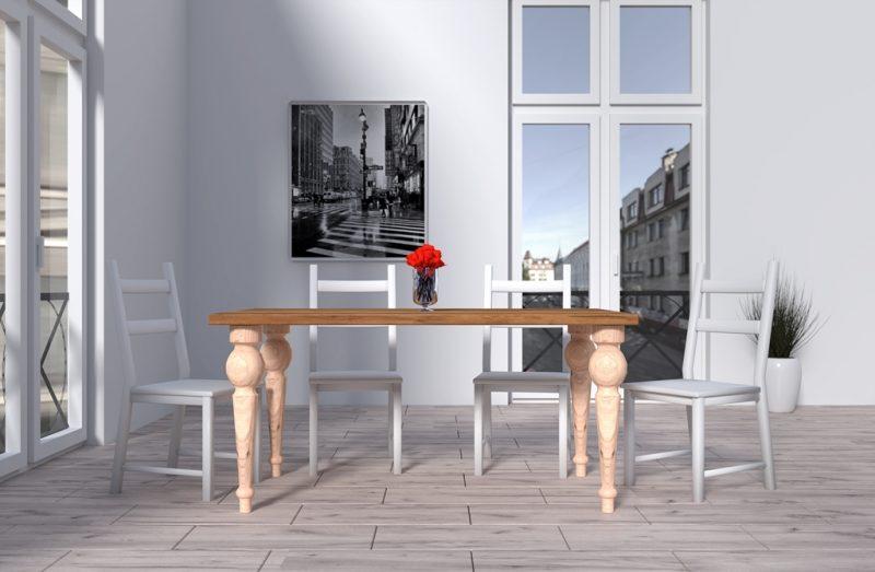 Drewniany stół z rzeźbionymi nogami